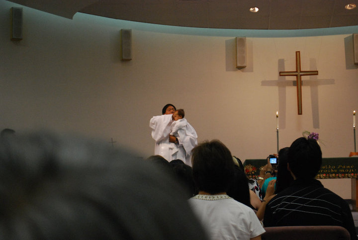 "Baptizing a baby in worship via aspersion or ""sprinkling."""