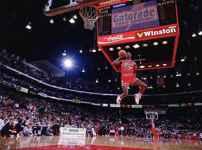 Michael Jordan doing one of his famous dunks.