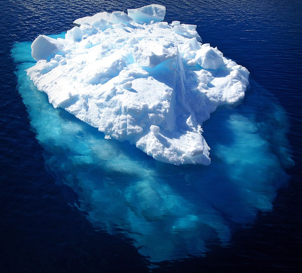 Beautiful picture of an iceberg that only hints at the mass beneath