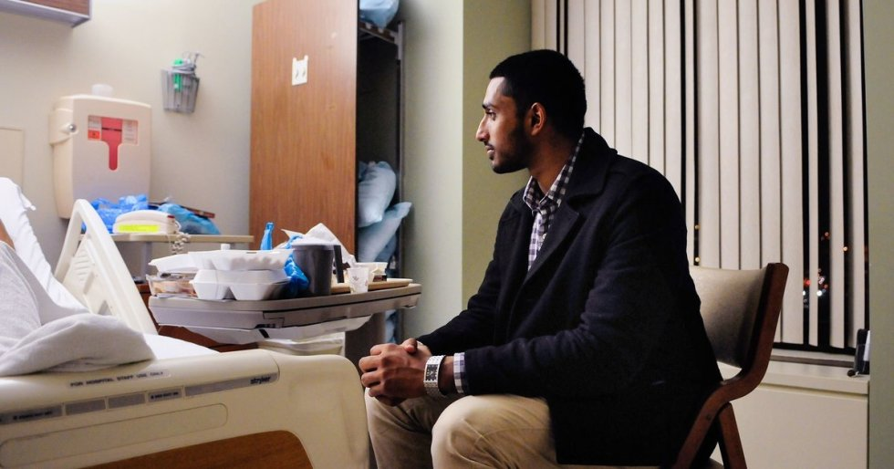 Wasiullah Mohamed, executive director of the Islamic Center of Pittsburgh, sits Friday with a cab driver who was shot Thursday morning. - image and caption thanks to Huffington Post