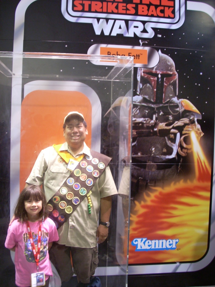 Combining many of the things I love - I'm posing in my Russell outfit from UP (Disney) at the San Diego Comic Con (Comics) in a Kenner Star Wars mock up of a Boba Fett action figure