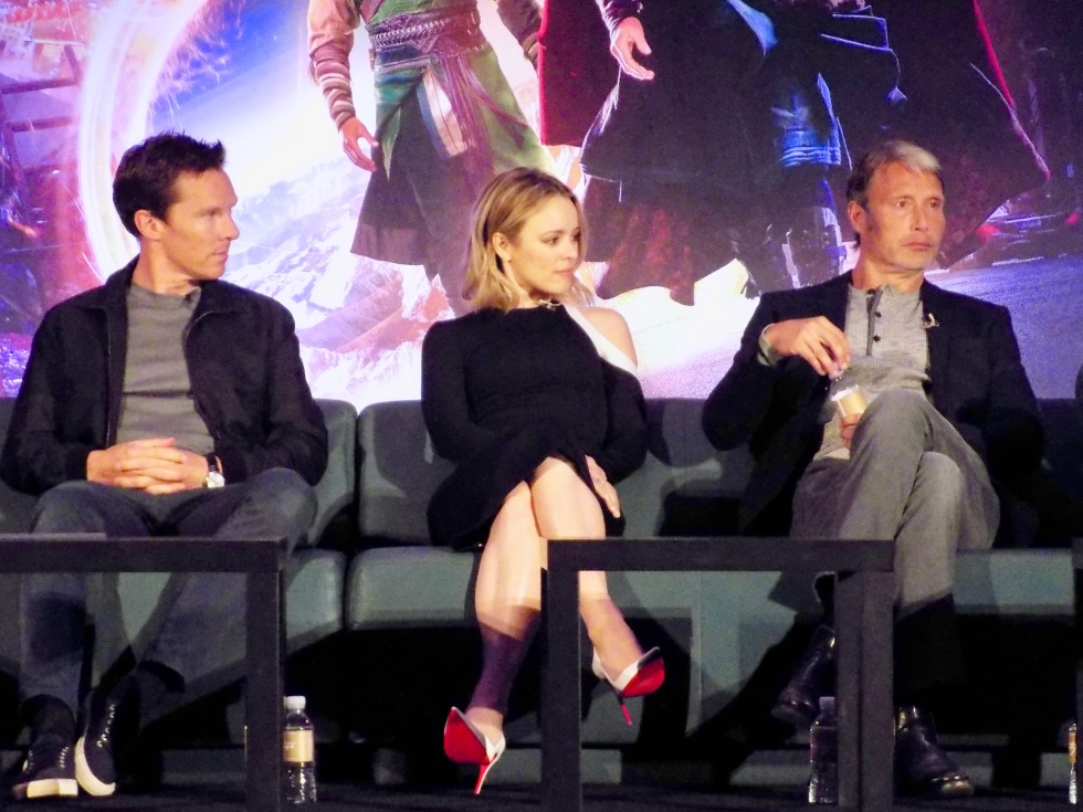 (L to R) Benedict Cumberbatch (Doctor Strange) and Rachel McAdams (Christine Palmer) listening to Mads Mikkelsen talking about his character Kaecilius