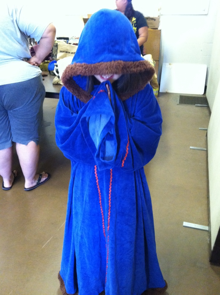 Emma dressing up in monk robes and praying (and smiling) back in 2012