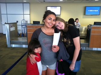 The girls giving Kristina a hug before she heads back home